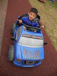 Client driving the Therapeutic Pedal Car
