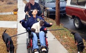 Figure 2. Client using the Wheelchair Dog Walker.