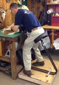 Figure 2. Client Using Fleshing Machine in Chair