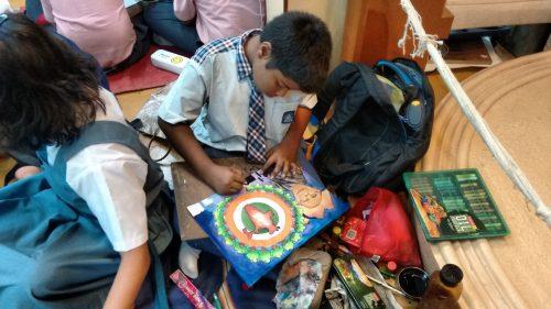 Fig. 4. Child artist at work in Mani Bhavan, Mumbai, 2017<br />Image courtesy Mani Bhavan Sangrahalaya and Gandhi Smarak Nidhi, Mumbai
