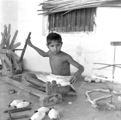 Fig. 8. A boy at the wheel, Sabarmati Ashram, Ahmedabad,<br /> Photograph by Pranlal Patel, c. 1940<br />Image courtesy the photographer's family