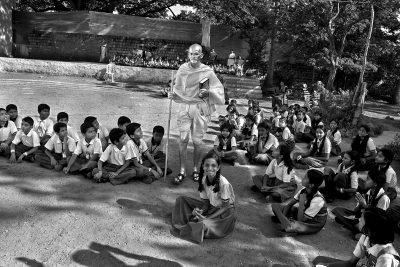 Fig. 4. Cop Shiva, Byagadehalli Basavaraju as Gandhi in school playground, Karnataka, photograph from the <em>Being Gandhi</em> series, 2012<br />© Cop Shiva, 2012