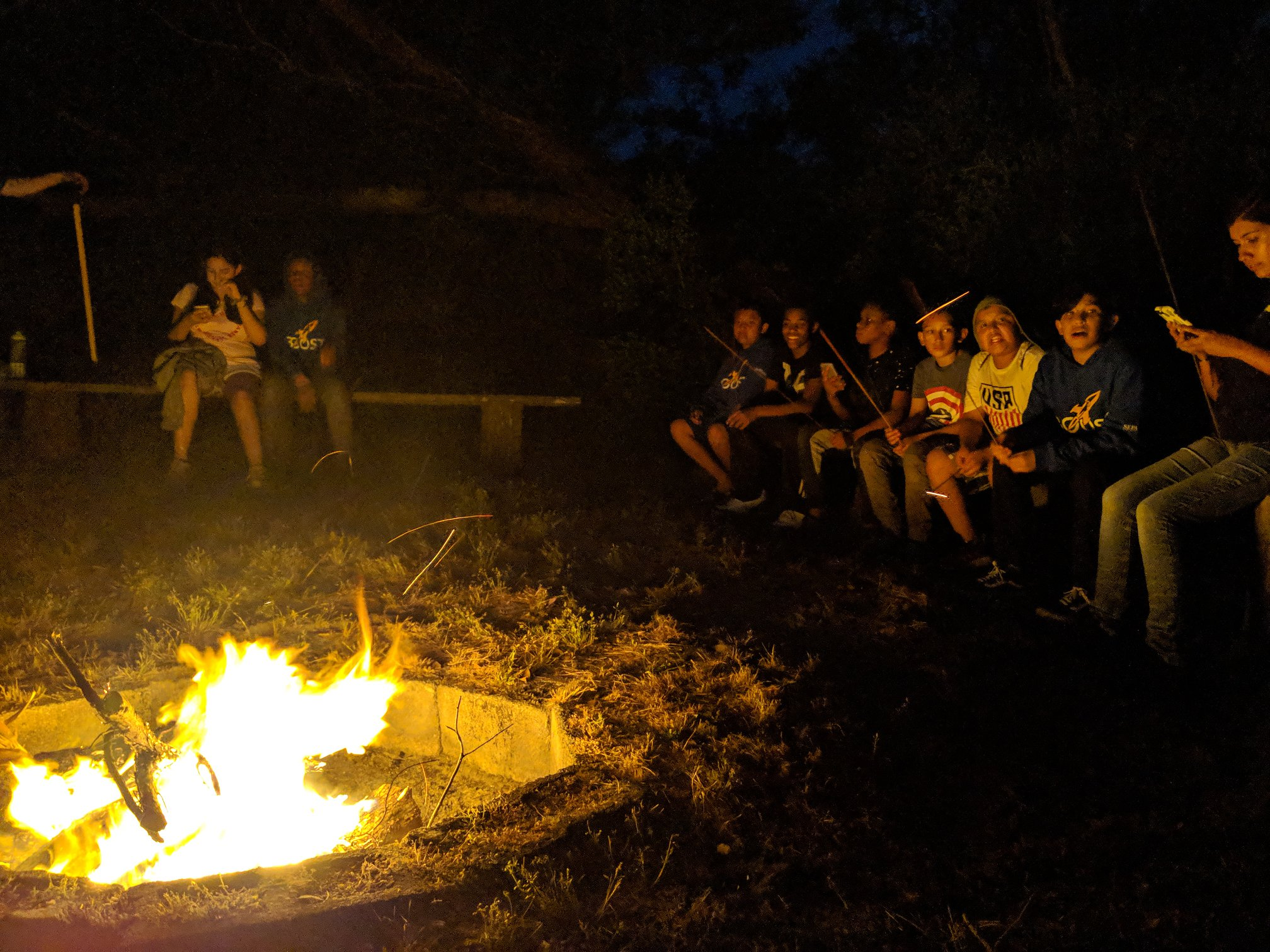 BOOST scholars tell stories around the annual Trinity Center campfire