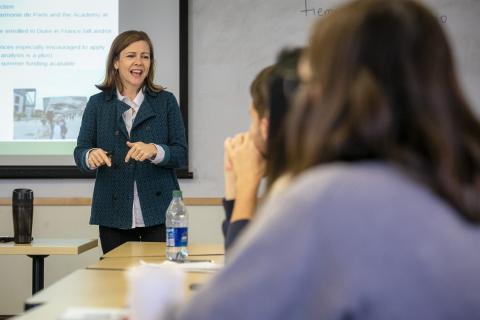 Woman speaking at front of classroom