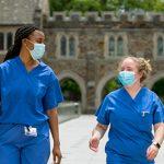 Healthcare workers walking across Duke Campus