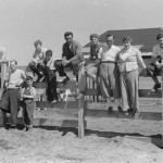 Family on Fence, Courtesy Van Eeden Collection, North Carolina Collection, University of North Carolina Library at Chapel Hill