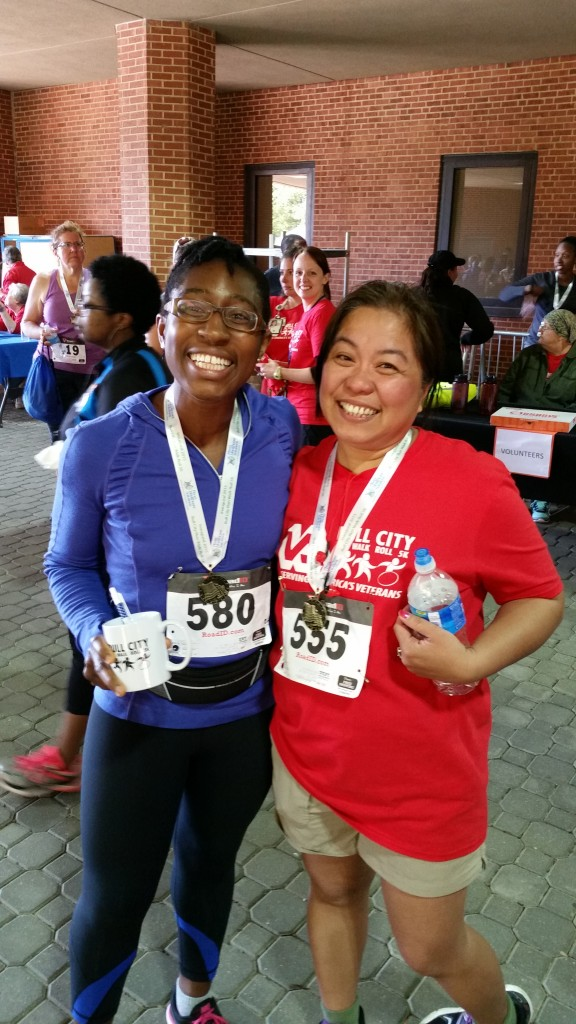 Iweala and a colleague after completing the first annual Bull City run in Durham.