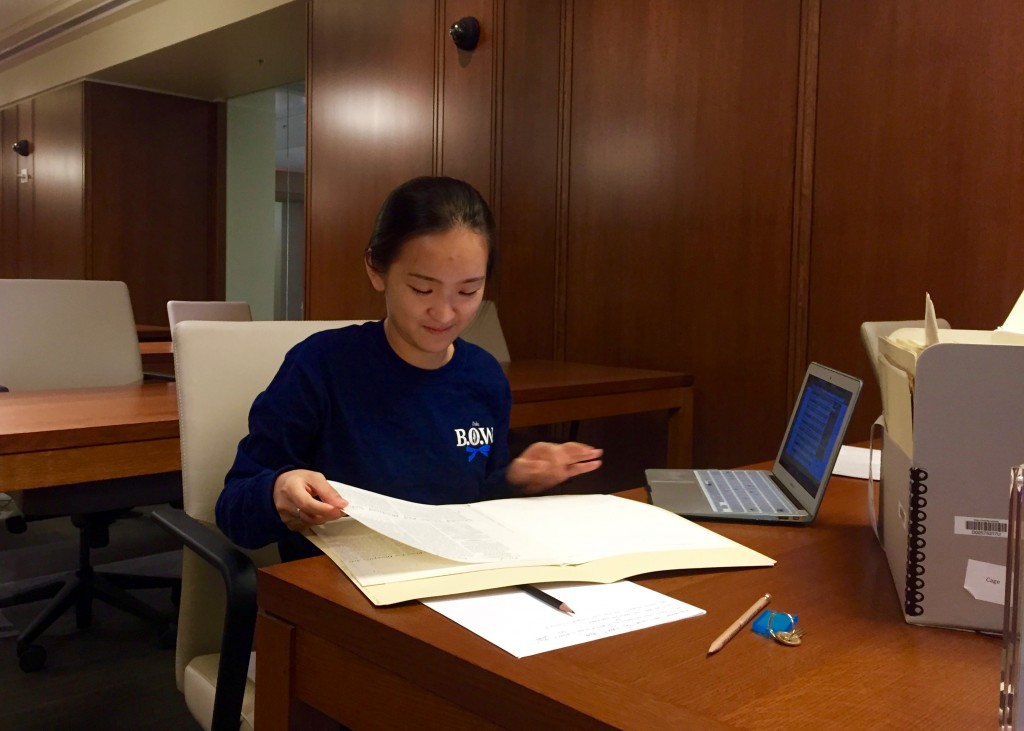 Kay Zhang pages through primary sources in Rubenstein.
