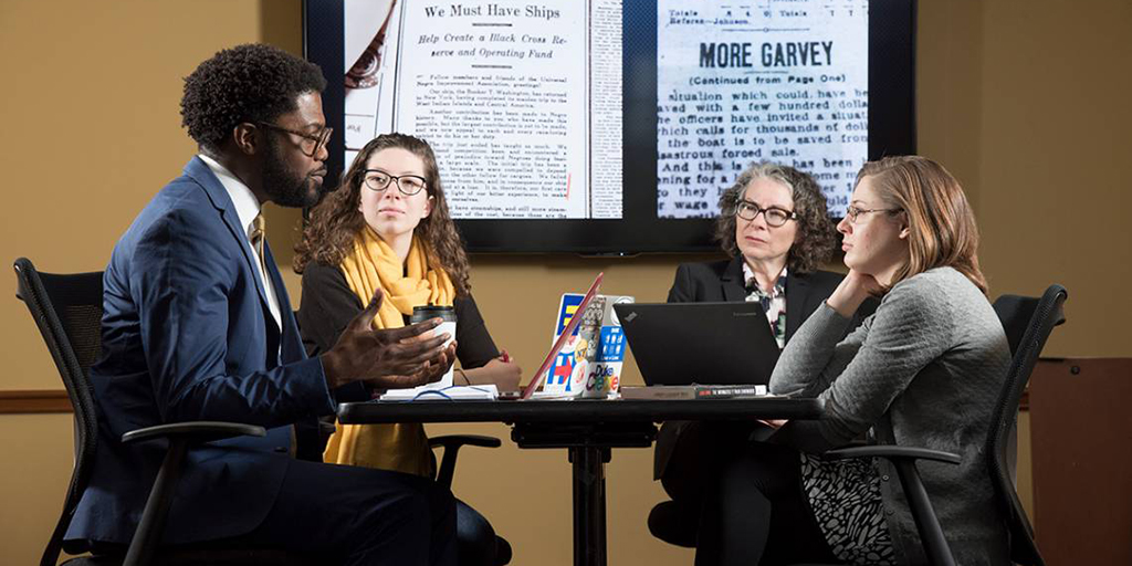 "The English department launched a pilot lab for the Humanities Unbounded proposal, ""Representing Migration."" Shown are Professors Charlotte Sussman and Jarvis McInnis with doctoral student Karen Little and sophomore Liddy Grantland. Photo by Les Todd"