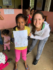 Melissa Marchese with a child in Peru