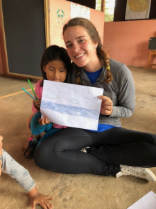 Kelsey Lansdale with a child in Peru