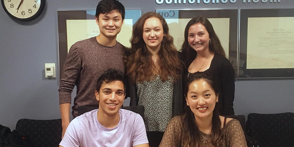 The Enabling Precision Health and Medicine Bass Connections sub team working on the WearDuke Initiative. First row, left to right: Nathan Parikh and Christine Wang; Back row: Grant Kim, Lauren Willis and Sarah Bond.