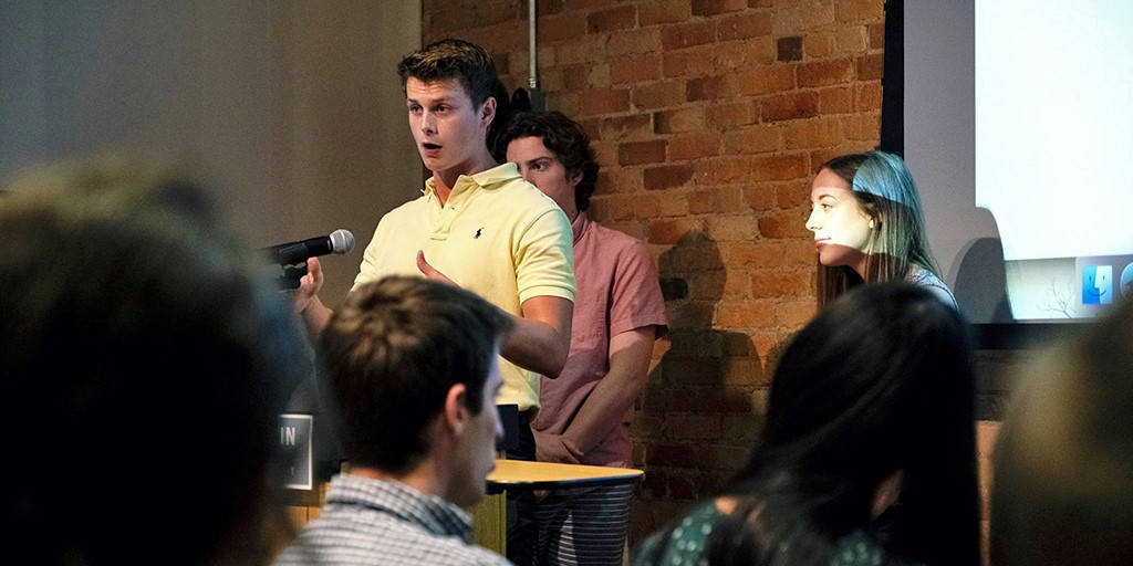 "Undergraduates Clifford Haley, Eli Kline, and Bailey Bogle present ""Pirating Texts"" at the 2019 Story+ Research Symposium. Photo: Jennifer R. Zhou."