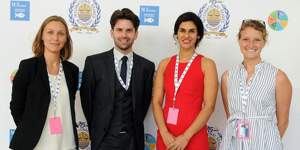 Phillip Turner (second from left) with Aline Jaeckel, Diva Amon, and Jessica Perelman at the 25th Session of the International Seabed Authority in Kingston, Jamaica.