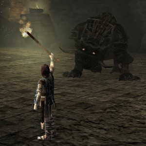 One of the colossi, cowering in fear of the player's torch. In order to kill it, the player must chase it off a cliff.