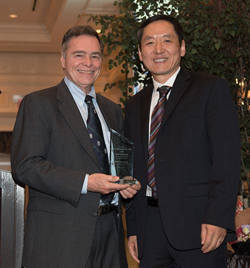 Dr. Sanfilippo receives an appreciation award from Dr. Huang
