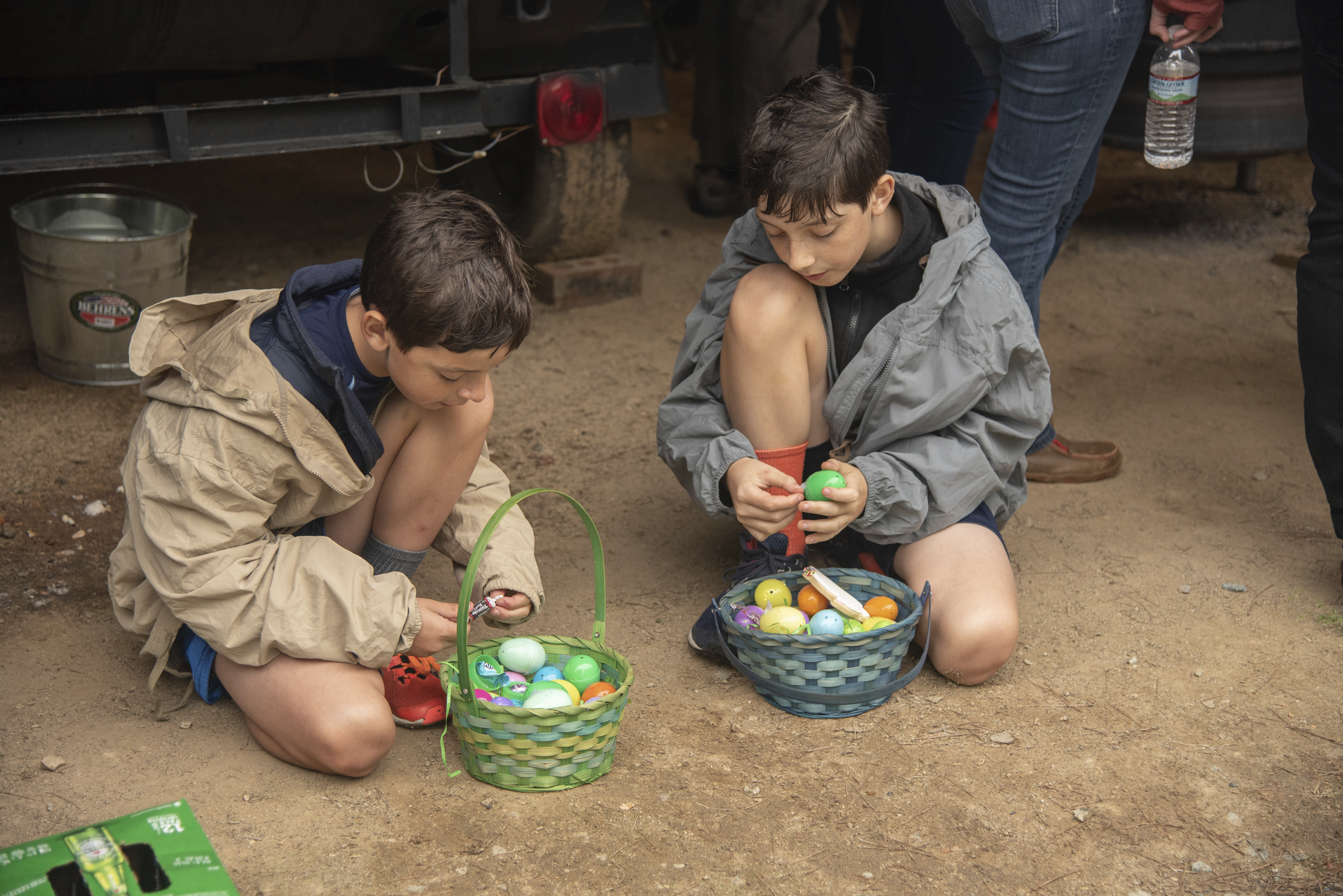 Two boys review the contents of their Easter Egg Hunt haul.