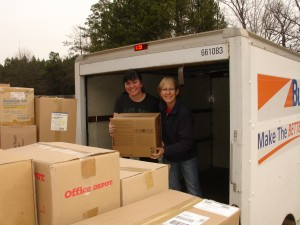 Marianne and Tessa unload last MW box 3-16-13