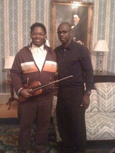 Lilian Thuram with Duke Romance Studies graduate student Reginald Patterson, who performed an adaptation of a Guadeloupean song for him, November 12, 2009