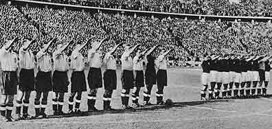 Another image exemplifying Hitler's influence in the sport. This is the Nazi salute, of which a Federal Office order mandated before each game as Hitler attempted to conquer all of Europe. By requiring the salute, Hitler felt every other nation was acknowledging on a deeper level that Germany was no longer a pariah state, but rather a superior force to be reckoned with.