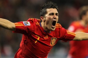 David Villa celebrates one of his many goals in the World Cup campaign. Photo by Oliver Weiken/EPA