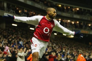 Henry wearing Arsenal's 03-04 shirt, with the O2 logo