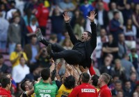 Mastermind Diego Simeone is thrown in the air by his players after winning the title