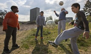 Young Belgian boys kicking the football around in the streets of Droixhe.