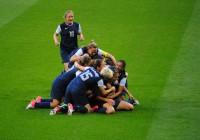 Members of the U.S. women's national team pile on top of one another following a victory over Japan in an Olympic gold medal math on Aug. 9, 2012.