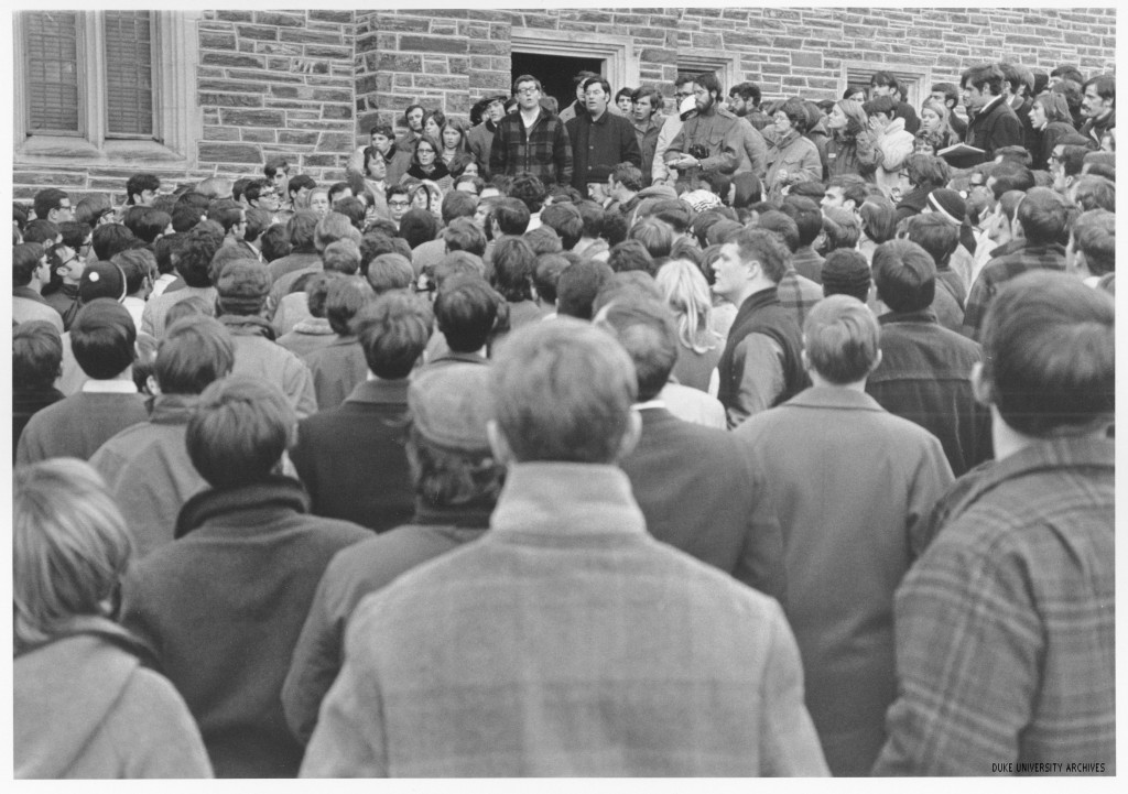 White students standing outside the Allen Building in support of the black students inside. [14]