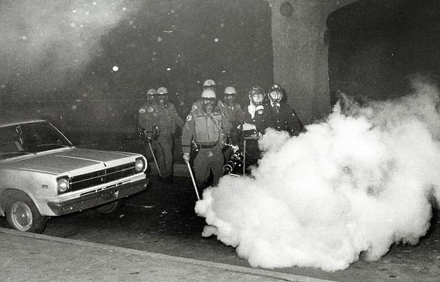 Showing the use of tear gas once the students had left the building[25].